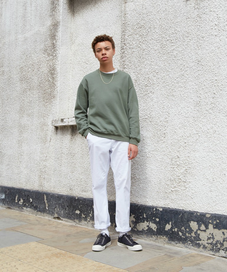 Muted tones white trousers green jumper
