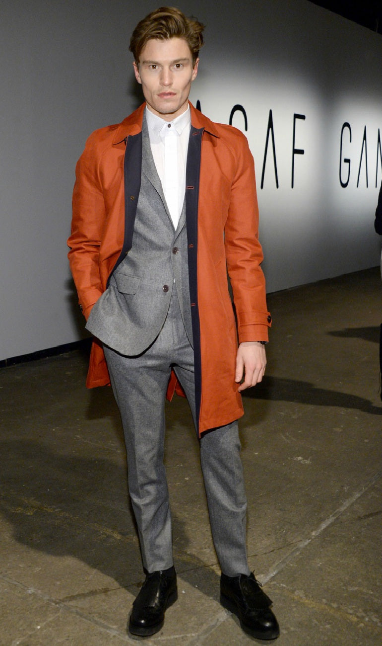 Oliver Cheshire wearing a grey suit