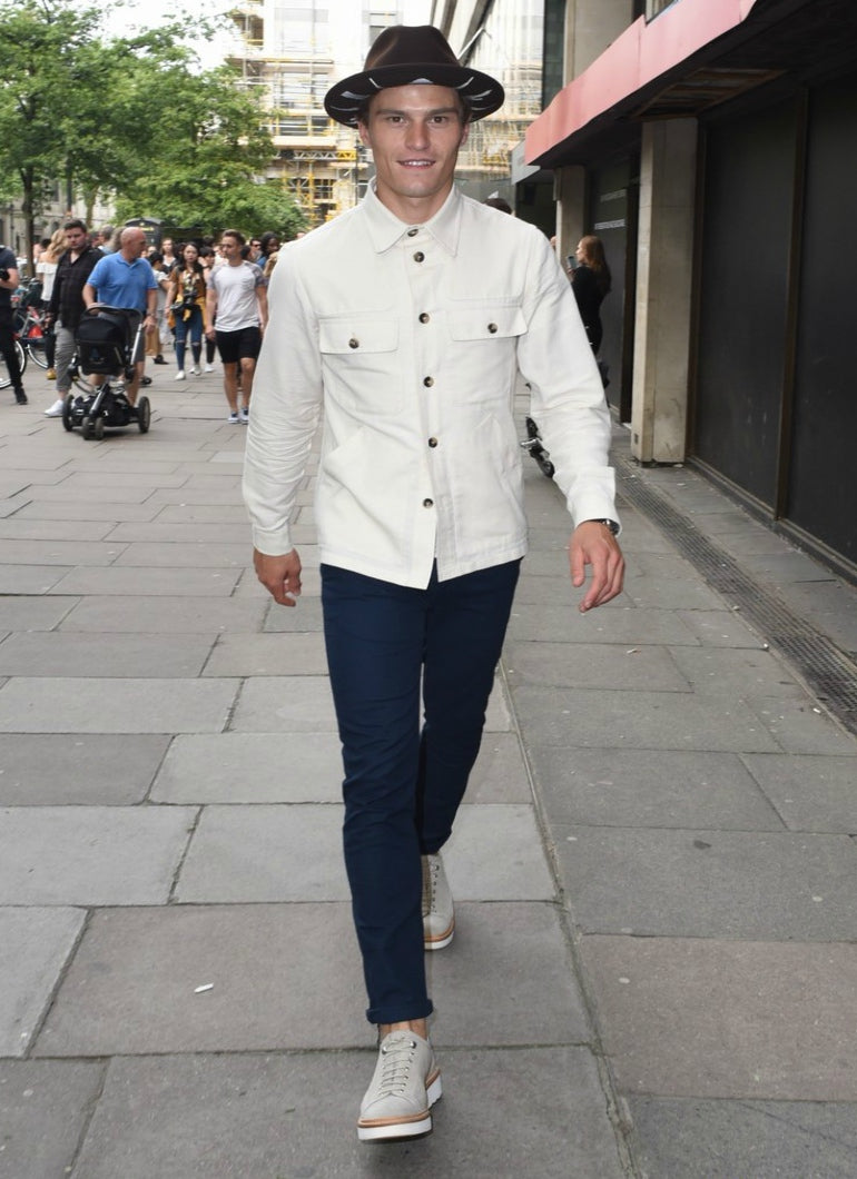 Oliver Cheshire wears a white denim jacket