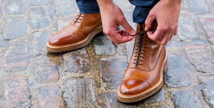 a pair of brown oxford boots