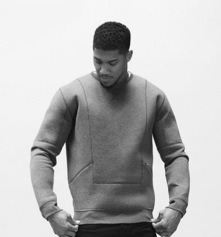 anthony joshua grey jumper black trousers mens street style