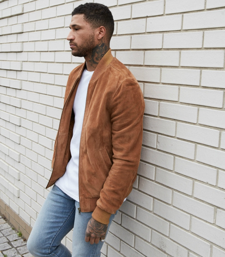 brown suede bomber jacket white t-shirt blue jeans mens street style