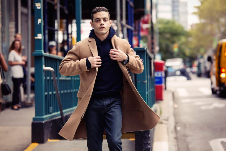 camel overcoat and navy hoodie street style