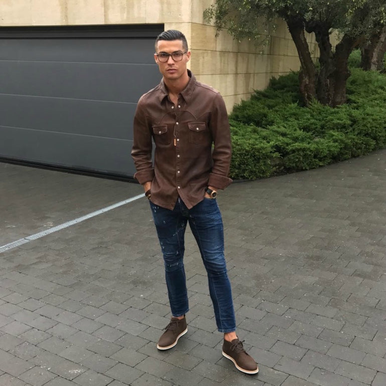 2aafceff7930 cristiano ronaldo wearing brown shirt blue jeans brown chukka boots mens  street style