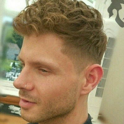 curly faux hawk haircut men