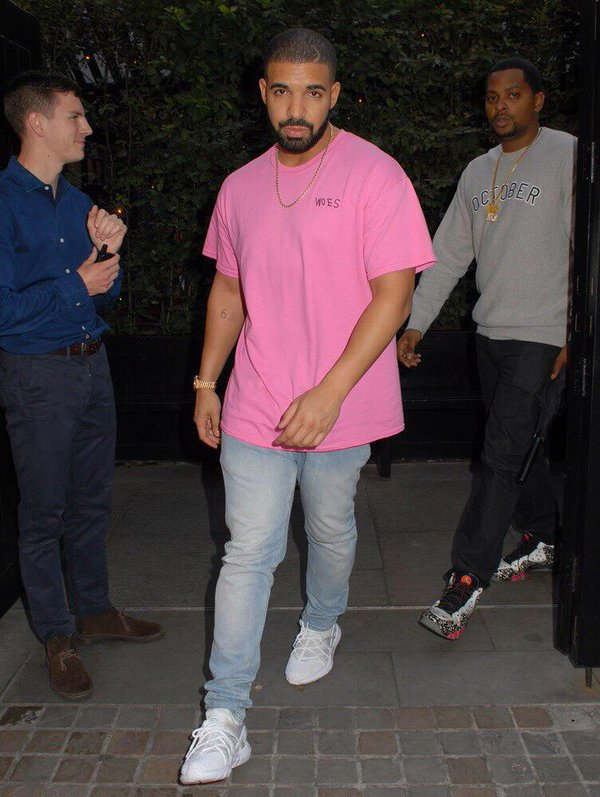 drake pink t shirt blue jeans white trainers mens fashion