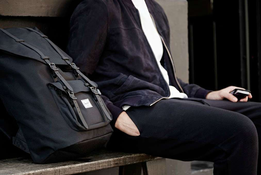 herschel black backpack with rubber straps how to wear a backpack men
