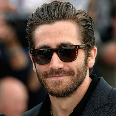 jake gyllenhaal beard slicked back hair mens