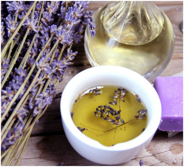 lavender oil in pot with flowers