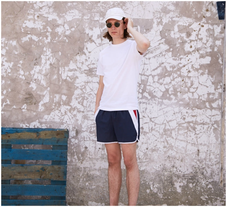 59ba9299ce60 lookbook mens style white tshirt blue runner shorts white cap