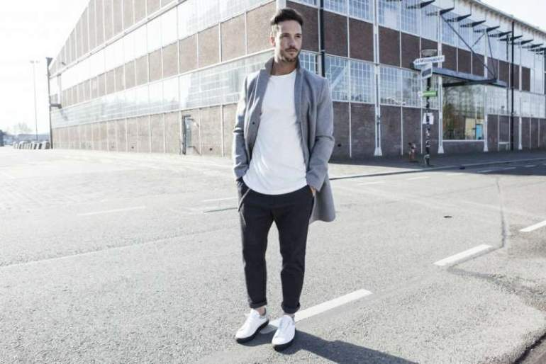 magic fox wearing a white t-shirt black trousers and white trainers mens street style