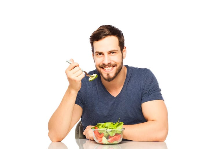 man eating vegetables salad