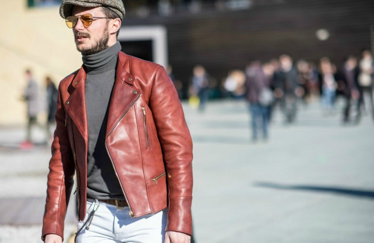 man in leather jacket and aviator sunglasses street style