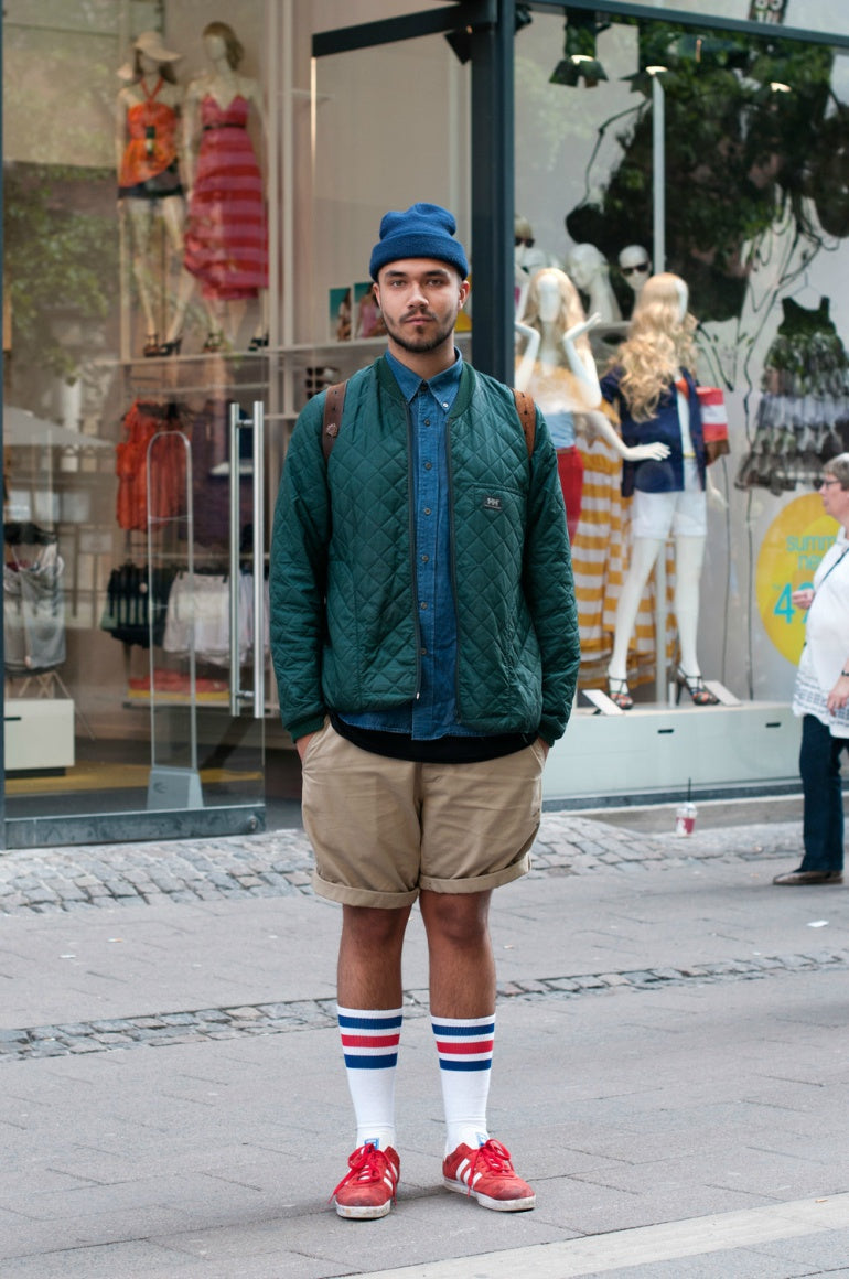 man in shorts street style