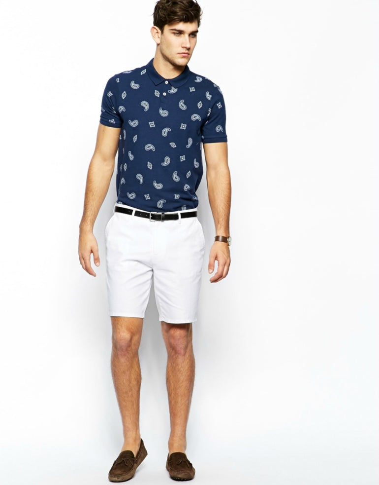 man in white shorts and loafers