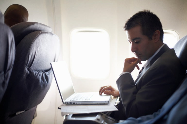 Man travelling on plane