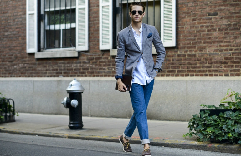 man wearing grey blazer with jeans mens