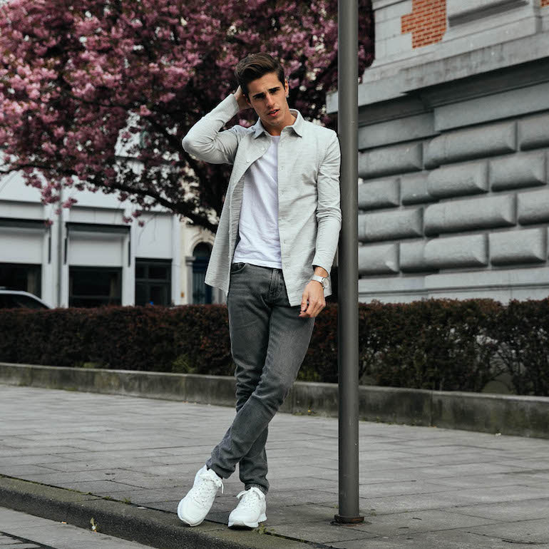 a587b0ac48775c man wearing grey jeans street style mens