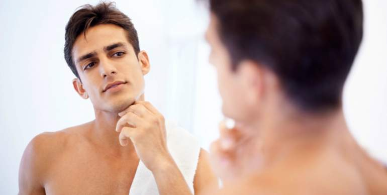 men looking mirror show clear skin