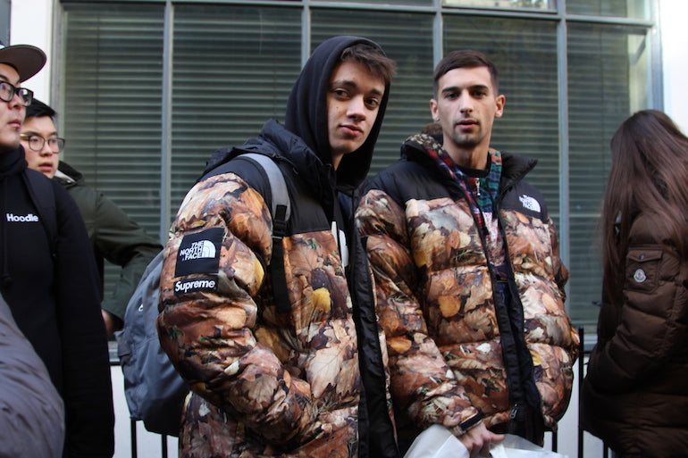 men wearing supreme x northface jackets street style