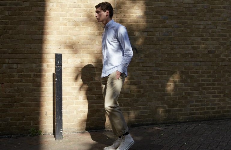 mens blue striped shirt street style tan chinos white converse trainers