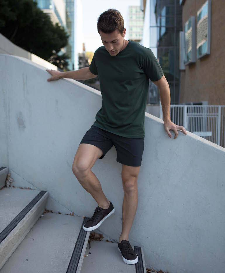mens green t shirt black shorts black and white trainers