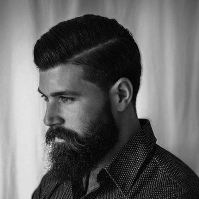 mens hard part hairstyle with beard