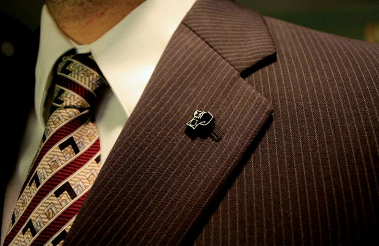 mens lapel badge on suit