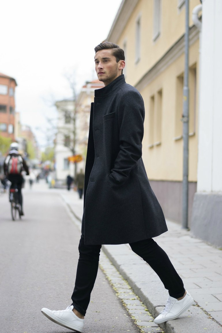 mens-overcoat-black-jeans-trainers