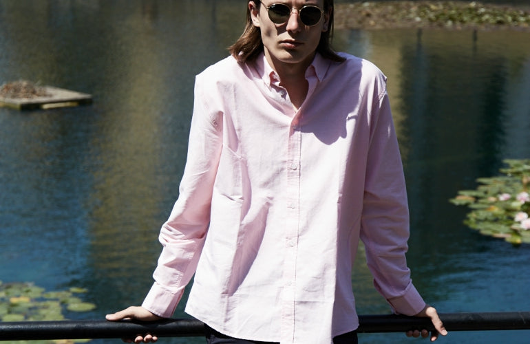 mens pink shirt street style glasses and shorts
