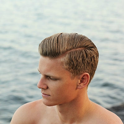mens short blonde side part pompadour hairstyle