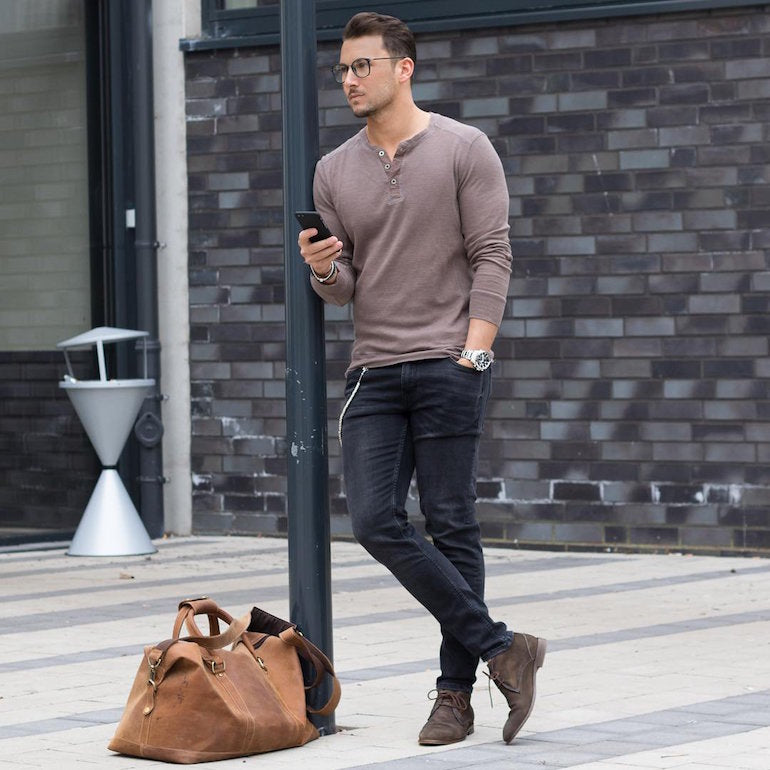 mens street style grey top black jeans brown desert boots