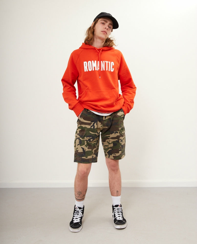red hoodie camo shorts black high top vans mens street style