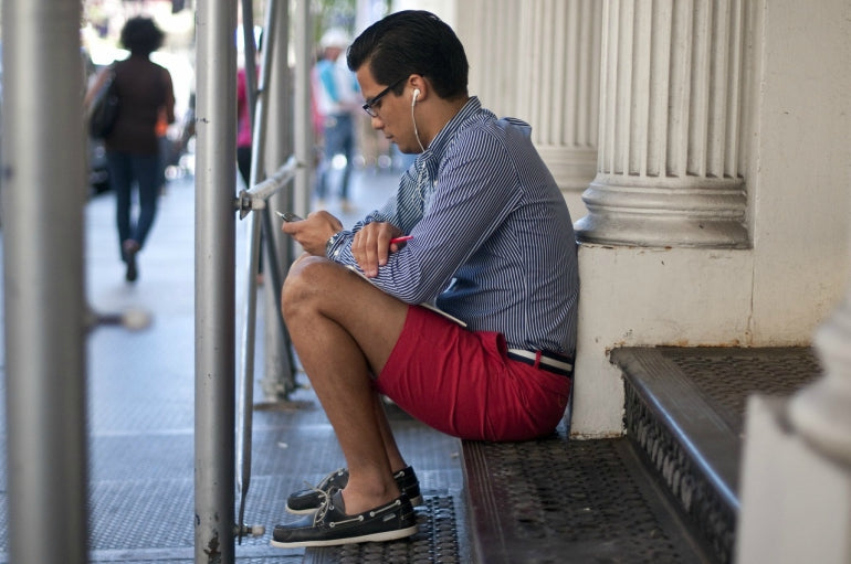 red shorts blue striped shirt boat shoes