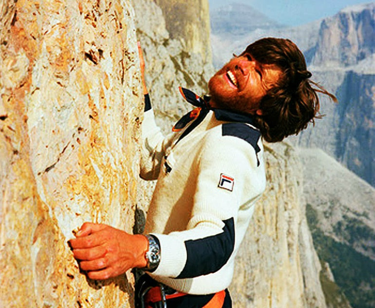 reinhold messner rock climbing in fila clothes