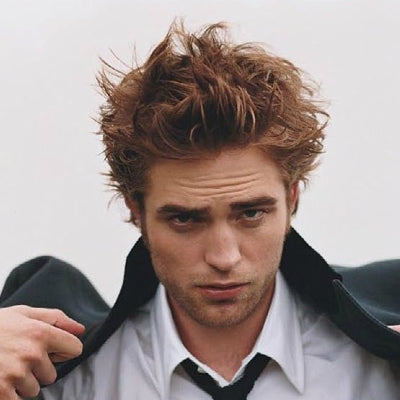 robert pattinson messy pompadour hairstyle