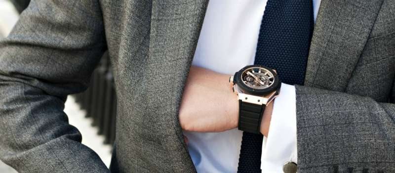 mens grey suit white shirt black strap watch silver face