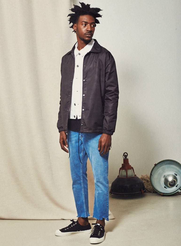 the idle man raw hem slim fit jeans for men with black jacket and white shirt