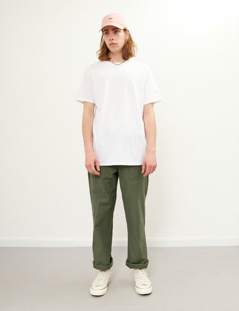 white t-shirt green chinos white trainers mens street style