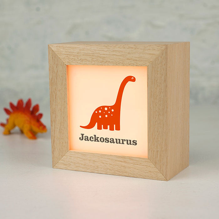 Personalised Dinosaur ligthbox in orange nursery lighting