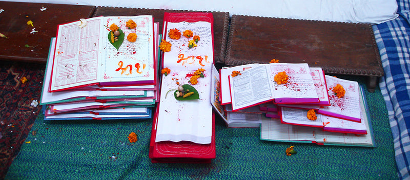 Red Stitched Ledgers after Diwali Pooja © 2015 Indika