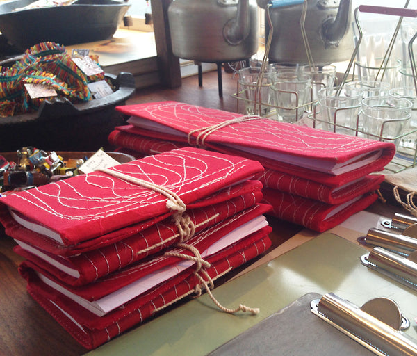 Red Stitched Ledgers and Notebooks © 2015 Indika