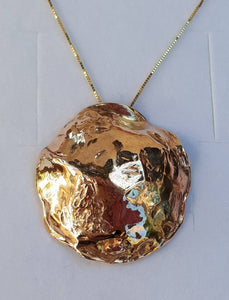 large gold pendant
