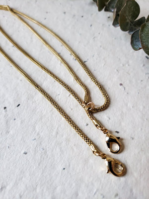 Raw brass snake link mask chain