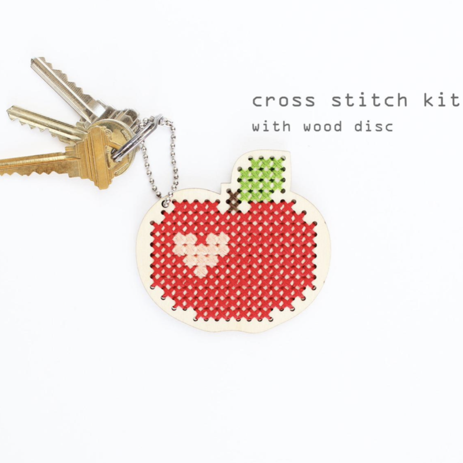 Red Apple keychain and backpacker cross stitch kit
