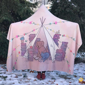 emposia pets and prose bookish hooded blanket for book lovers worn by a girl standing in the snow