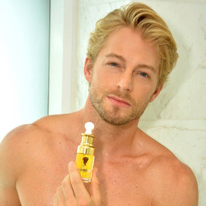 Fabio Grangeon, ambassador for Alvi Beauty Care, holding a bottle of Arganne 100% Pure Argan Oil. 阿甘倪摩洛哥纯正阿甘油