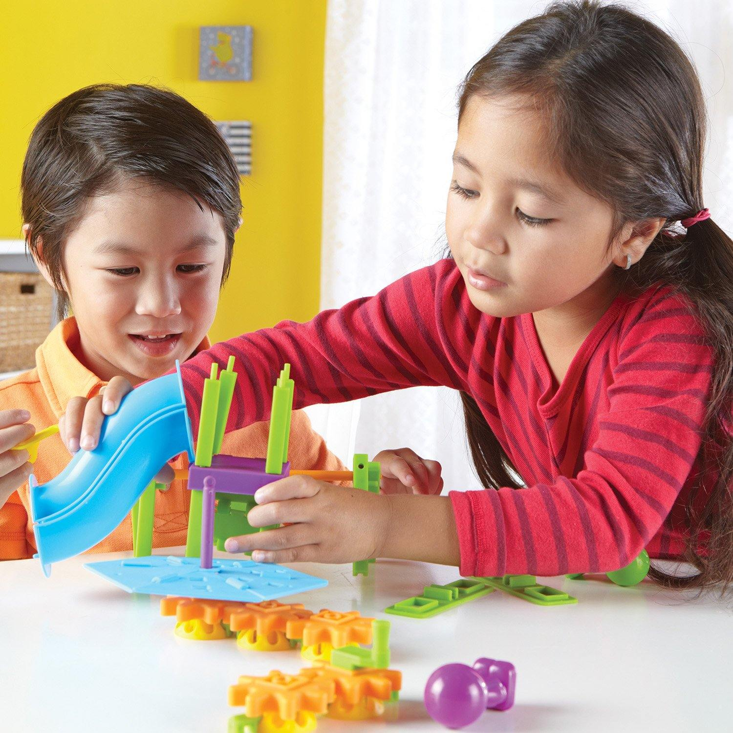 Children playing with playground engineering kit