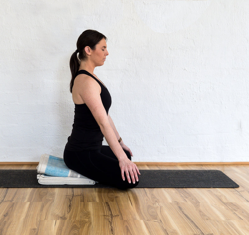 Simple cross-legged pose (sukhasana) using yoga blanket
