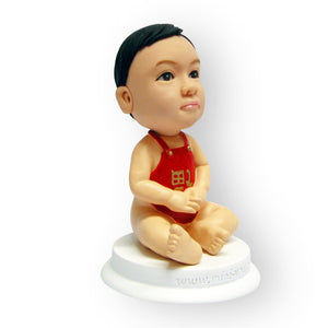 Baby in an Apron Figurine